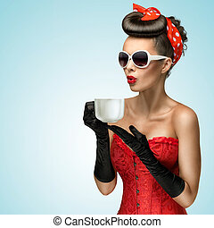 Hot beverage. - Three-quarter portrait of glamourous pinup...