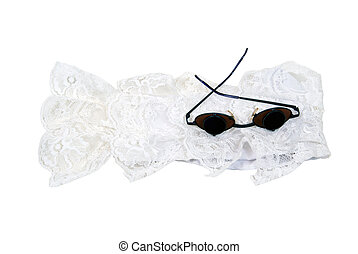 Retro Glasses and lace - A pair of retro glasses used to...
