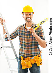 Handsome and handy. Cheerful young manual worker holding...