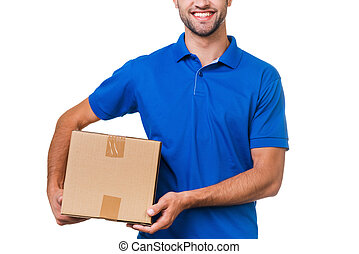 Your package is in safe hands. Cropped image of young courier holding a cardboard box and smiling while standing against white background