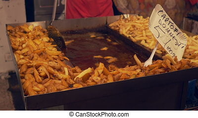 Cooking Fries on Large Tray - Cook is preparing tasty...