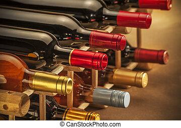 Wine bottles - wine bottles stacked on wooden racks shot...