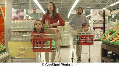 Shopping Day - Family of four approaching camera walking...