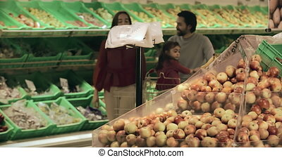 Shopping Together - Close up of family shopping for apples...