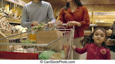 Little Shoppers - Kids putting bread in shopping cart