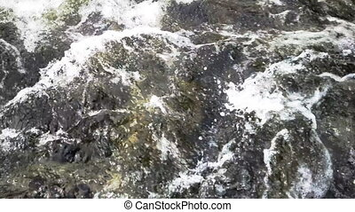 closeup of rapid waters of river strong - river water is a...