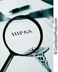 HIPAA document with magnifying glass...