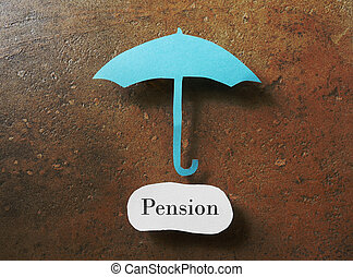Pension plan - Paper umbrella over a pension message...