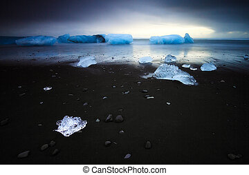 Dark black ice - Beautiful beached chunks of ice at the...