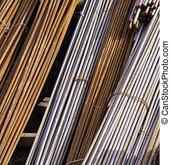 detail of bundled steel reinforcing metal cable rods - color...