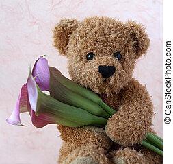 teddy bear with calla lilies - teddy bear holds a bunch of...