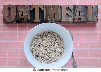 bowl of oatmeal - bowl of raw oatmeal with the word oatmeal...