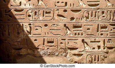 Hieroglyphics at the Karnak temple in Luxor Egypt -...