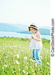 little girl  in daisy field