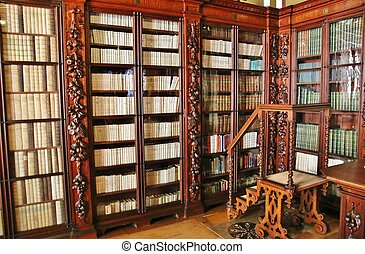 Shelves with old books in the library