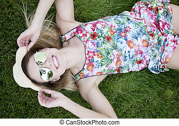 Smiling Pretty Young Woman Lying on the Grasses - Pretty...