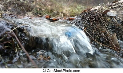 clean Creek water and plastic trash bottle - plastic trash...