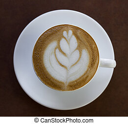 Cup of art latte or cappuccino coffee.