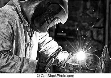 Welder at work. Black and white