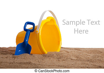 An bucket and shovel on the beach with copy space - An...