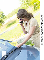 woman looking on parking ticket - Suprised woman looking on...