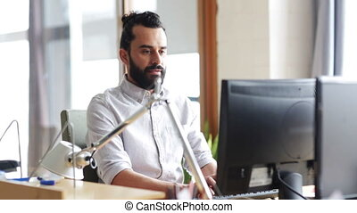 happy creative male office worker with computer - business,...