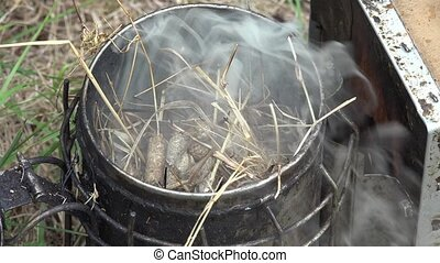 bees smoker - Preparing the smoker with dry herbs