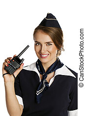 Beautiful smiling stewardess with cb radio, isolated on a...