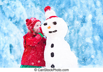 Funny toddler playing with snow - Funny little toddler girl...