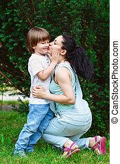 Loving mother kissing her son