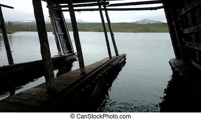 old ship dock on the lake - ship dock on big lake in middle...
