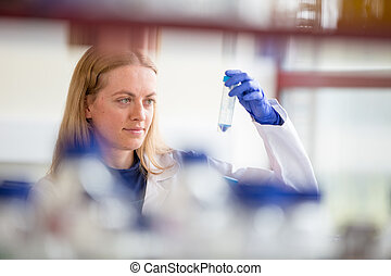 Portrait of a female researcher doing research in a lab...