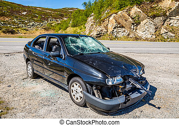 Car wreck - Norway, highway 7. Damaged car is parked on a...