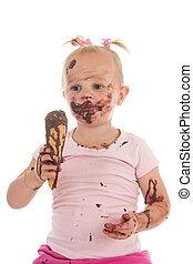 Toddler girl eating ice cream - Portrait toddler girl eating...