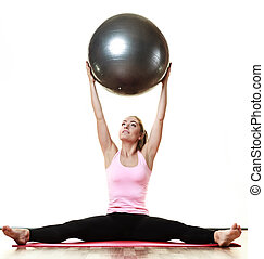 woman doing fitness exercise with fit ball - sport,...