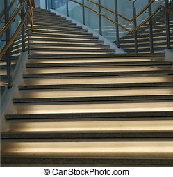Curved Staircase with Lighting - A curved staircase leading...