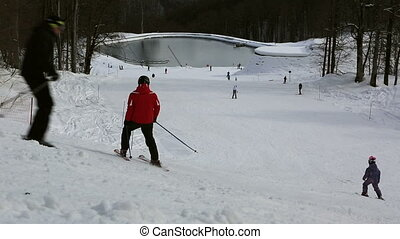 Ski slopes and artificial lake in Rosa Khutor Alpine Resort