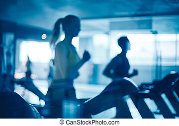 People in gym - Figures of humans running on treadmills in...