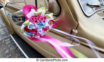 Beautiful red wedding bouquet on the car