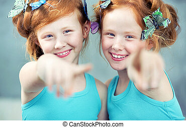 Portrait of two cheerful redhead twins - Portrait of two...