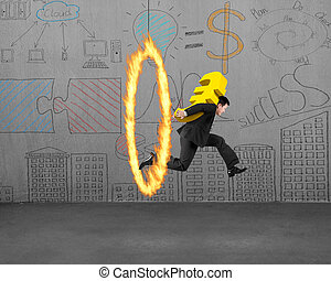 Businessman carrying golden euro sign jumping through fire...