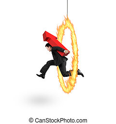 Businessman carrying red arrow up sign jumping through fire...