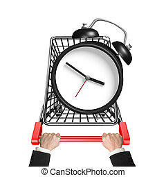 Hands pushing shopping cart with alarm clock, high angle...