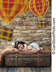 Cute boy sleeping on the luggage - Cute child sleeping on...