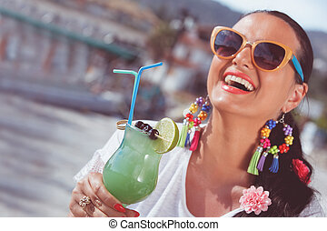 Happy young woman drinking cocktail - Happy young woman...