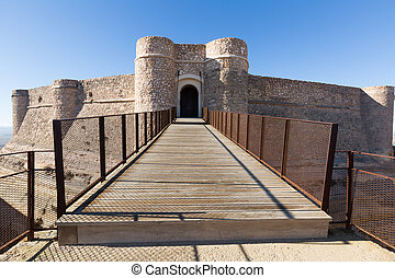 Gate of castle at mount. Chinchilla - Gate of castle at...