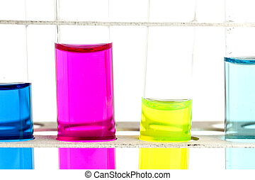 science concept - chemistry lab glassware equipment (test tubes with colorful substances)