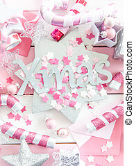 Pink christmas decorations with glittery ornaments on...