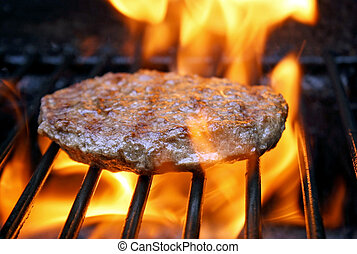 Juicy beef burger sizzling on grill - Juicy beef burger...