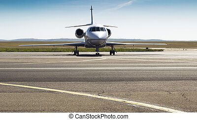 dream to fly - front of the parked private airplane on the...